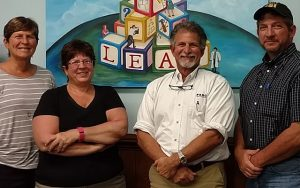 From Left to Right: Diane Gordon, Julie Clarke, Mark Latino, and Bob Latino are four of the five siblings who own and operate The Reliability Center.