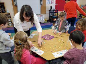 Cieana Detloff instructs a first grade class during Engineers Week